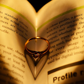 An Engagement Ring actually has a HEART within the same. Even the aura around the ring, is that of a HEART (Take a look at the shadows both inward and outward).  by Dibyendu Banik - Novices Only Objects & Still Life ( love, ring, heart, life, romance )