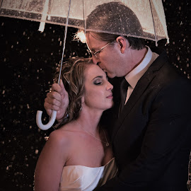 Raindrops by Junita Fourie-Stroh - Wedding Bride & Groom ( flash, wedding photography, umbrella, wedding dress, professional wedding photographer, night photography, wedding, wedding day, raindrops, bride and groom, wedding photographer, destination wedding photographers, rain )