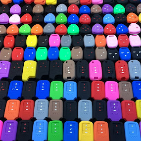 Multi-colored car remote controls by Wan Loy Yeong - Abstract Patterns ( car, thailand, display, khet ratchathewi, remote, krung thep maha nakhon, sale, multicolored,  )
