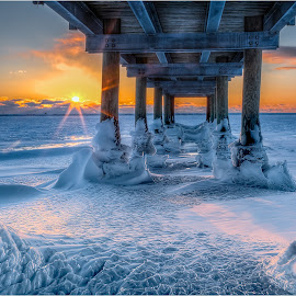Under the Pier at Sunset by John Witt - Buildings & Architecture Bridges & Suspended Structures ( frozen beach, under pier, gallagher, winter, buffalo waterfront )