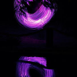 At Least It's Something... by Savannah Eubanks - Abstract Light Painting ( pond, leaves, reflection, light, symmetry, night, dark, black, light painting, purple, circle, lines )