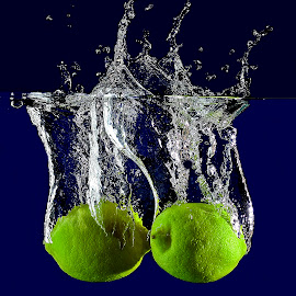 sparkling lemon. by Pete G. Flores - Food & Drink Fruits & Vegetables ( blue, yellow, lemon food fruit vegetables drop water otep splash sparkling )