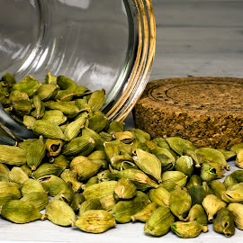 cardamom pods poured from a jar by Gitti S - Food & Drink Ingredients ( flavorful, still life, seed, green, spice, food, pods, flavor, agriculture, food photography, flavorsome, cardamom )