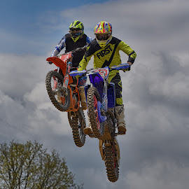 First ... And Second ! by Marco Bertamé - Sports & Fitness Motorsports ( clouds, speed, fight, fitst, number, yellow, race, noise, jump, close, number3, flying, two, red, motocross, blue, grey, air, high, duel )