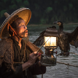 Blackbeard with Lantern by David Long - People Professional People ( li river, cormorant fisherman, guilin )