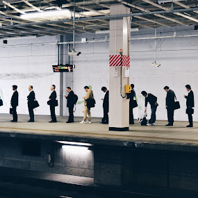 Japan rail by Valentina Cantera - Transportation Trains ( waiting, japan, underground, train station, men, asia, shinkansen, row, rows, people, train, order )