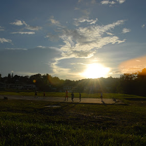 by Muhammad Muqri - Sports & Fitness Australian rules football ( football, sunset, street, sport, people )