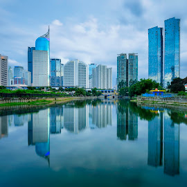 Mirroring City by Peter Mendrofa - City,  Street & Park  City Parks ( cityscapes, skyline, reflection, indonesia, buildings, reflections, skycrapers, skylines, jakarta, cityscape, landscapes, landscape, nikon, longexposure, river,  )