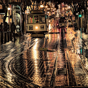 Rainy Night on Powell Street  by Terry Scussel - City,  Street & Park  Street Scenes ( cable cars at night scenes, cable cars, powell street, powell street cable cars, san francisco, san francisco cable cars )