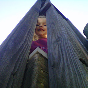 Play ground peek by Erin Meisner - City,  Street & Park  Neighborhoods ( child, wood, play, looking up, peek a boo,  )