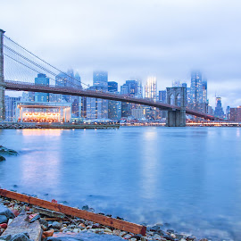 Brooklyn Bridge into the city by Carol Ward - City,  Street & Park  Skylines ( sticks, night time, manhattan, dumbo, nyc, brooklyn )