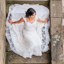 Bride by Bugarin Dejan - Wedding Bride ( stairs, wedding, beautiful, white, stone, wedding dress, smile, bride, posing, hair, portrait )