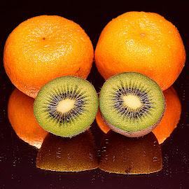 Kiwis & tangerines. by Andrew Piekut - Food & Drink Fruits & Vegetables