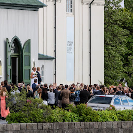 summer wedding by Hafsteinn Kröyer Eiðsson - Wedding Ceremony ( car, fancy, street, door, stone, road, yellow, leaves, people, reykjavík, daytime, tree, grey, couple, church door, flowers, crowd, black, church, green, colors, white, happiness, iceland, red, blue, bushes, dress, wedding, suit, trees, summer, stones, wall )