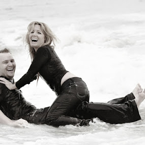 Fun in the water by Scott Nelson - People Couples