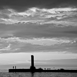black and white sunset by Fraya Replinger - Black & White Landscapes ( water, black and white, sunset, lighthouse, summer, lake )