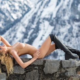 mountain view by Reto Heiz - Nudes & Boudoir Artistic Nude ( blonde, mountains, sexy, nude, stonewall, outdoor, female nude, boots )