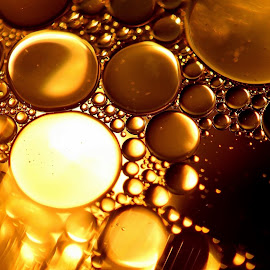 Do not mix by Kim White - Abstract Macro ( do not mix, abstract, water, texture, art, random, bubbles, sphere, oil, shapes, liquid, pattern, fluid, repel, golden )