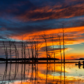 by Blaine Stauffer - Landscapes Sunsets & Sunrises ( hunters, waterscape, sunset, cloudscape, canoe )
