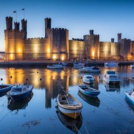 Caernarfon Castle, Wales by George Johnson - Buildings & Architecture Public & Historical ( history, lights, water, port, reflection, boats, harbour, sea, castle, night, landscape, dusk )