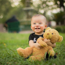 Baby and teddy bear by Mario Perez - Babies & Children Toddlers ( teddy bear, happy, sunny day, smile, toddler, green grass )