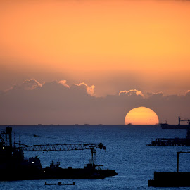 Sunset on Claxton Bay by Leslie-Ann Boisselle - Novices Only Landscapes ( orange, blue, silhouette, sunset, ocean, sun,  )