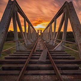 Old bridge. by Piotr Dominiak - Uncategorized All Uncategorized ( water, sunset, d7100, long exposure, bridge, nikon, sun, river, poland )