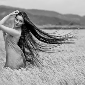 With the wind by Cvetka Zavernik - People Portraits of Women ( wind, nature, black and white, hair, women )
