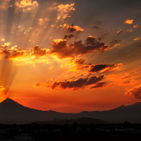 Volcanoes and sunset by Cristobal Garciaferro Rubio - Landscapes Sunsets & Sunrises ( clouds, cholula, mexico, iztaccihuatl, puebla, pwcsunbeams, popocatepet, rays, sun )