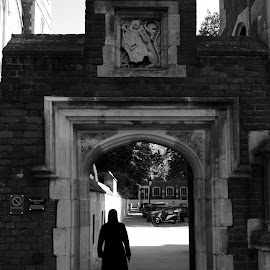 Gateway to the Law by DJ Cockburn - Buildings & Architecture Other Exteriors ( legal, walking, monochrome, newman's row, lincoln's inn fields, gateway, arch, black and white, silhouette, gate, grayscale, england, london, inns of court, wc2a, redbrick, holborn )