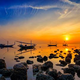 Sunrise at Kenjeran by Indrawaty Arifin - Landscapes Waterscapes ( kenjeran, boats, sunrise, seascape, rocks, surabaya )