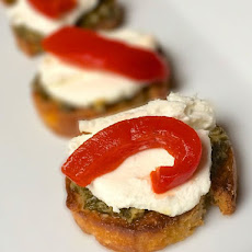 Goat Cheese Crostini with Pesto and Roasted Red Peppers