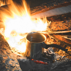 Fire in the nature by Deyan Georgiev - Food & Drink Cooking & Baking ( countryside, wood, travel, people, hiking, flame, camp, adventure, nature, camping, dark, tent, cooking, firewood, fireplace, campfire, light, man, wild, tourism, forest, leisure, young, smoke, fire, bonfire, tourist, environment, vacation, outdoors, outdoor, campsite, summer, hot, night, burn, natural, outside, picnic )