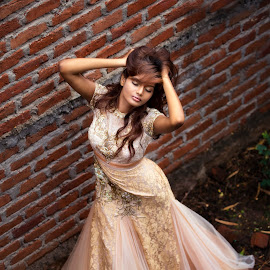 absconded  by Rakesh Kurra - People Fashion ( girl, brick, clar, gown, wall, rakesh )