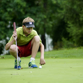 Lining It Up by Victor Wiebe - Sports & Fitness Golf ( concentration, green, sports, children, golf )