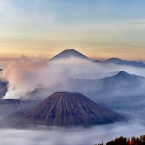 Beautiful sunrise at Mt. Bromo, East Java by Pak Lang - Landscapes Mountains & Hills ( clouds sky, tengger, peak, volcanic, cone, hiking, attraction, island, mystic, adventure, blue sky, volcano, sunny, indonesia, batok, east, bromo, national, backgrounds, damage, journey, cloudscape, caldera, trek, smoke, gas, crater, climbing, mount, asheville, voyage, fog, active, java, sunrise, semeru, natural, eruption, mist, steam )