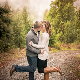 Love, Rain and Laughter  by Michael Keel - People Couples ( kiss, redwoods, marriage, couples, engagement )