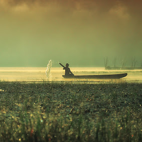 the umbrella water by Yoga Amerta - People Street & Candids ( nature picoftheday lake mist people )
