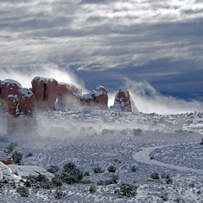 Drifting Fog from Double Arch by Logan Knowles - Landscapes Cloud Formations ( contrast, winter, arches national park, fog, dramatic )
