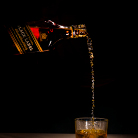 Black Label by Paul Cousins - Food & Drink Alcohol & Drinks ( on the rocks, johnny walker, whiskey, black label, pouring, bottle )