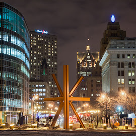 The Calling, Wisconsin Ave, Night by William Rieselbach - City,  Street & Park  Night ( wisconsin, street, travel, architecture, cityscape, landscape, usa, city, milwaukee, sky, night photography, buildings, weather, cloudy, long exposure, nikon, light, clouds, art, camera, places, nightscape, urban, sculpture, winter, astro, season, color, outdoor, artistic, night, public art )