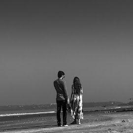 Couple at beach by Debajit Bose - People Couples ( black and white, couples at beach, couple, beach, people )