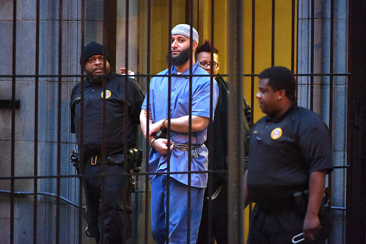 Officials escort 'Serial' podcast subject Adnan Syed from the courthouse following the completion of the first day of hearings for a retrial in Baltimore on Wednesday, February 3, 2016