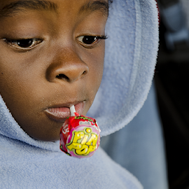 the lollipop by Barbara Springer - Babies & Children Child Portraits ( sweet treat, child, headshot, hoodie, african, lollipop, boy,  )