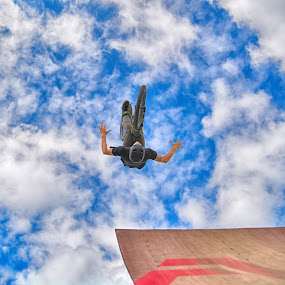 Hands Free Flying by Marco Bertamé - Sports & Fitness Other Sports ( clouds, wood, letter, a, dow, stunt, helmet, upside down, ramp, jump, bicycle, flying, hands free, red, sky, blue, cloudy, grey, brown, air, high,  )
