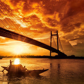 The Last Sailor's Sunset by New Vision - Landscapes Sunsets & Sunrises ( nature, color, kolkata, sunset, the ganges, india, landscape, vidyasagar bridge )