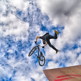Acrobatic Stunt by Marco Bertamé - Sports & Fitness Other Sports ( clouds, wheel, wood, letter, speed, a, dow, stunt, jump, bicycle, ramp, acrobatic, flying, two, sky, red, blue, cloudy, air, grey, brown, ¨high )