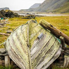 Resting on land by Annette Nordlinder - Transportation Boats ( old, green, land, boat, upside down )
