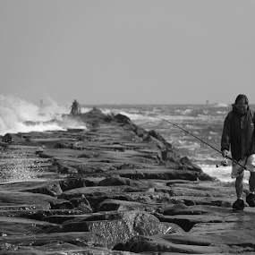 Greatful Fisherman by Rusty Jhorn - News & Events Weather & Storms ( lifeguard, black and white., rescue, ocean, fishing,  )