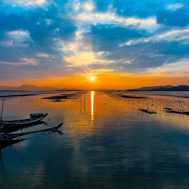 Sunset view at Yanzhou Island, Huidong, China by Stanley Loong - Landscapes Sunsets & Sunrises ( water, clouds, reflection, blue sky, waterscape, relax, sunset, warmth, scenery, landscape, boat,  )